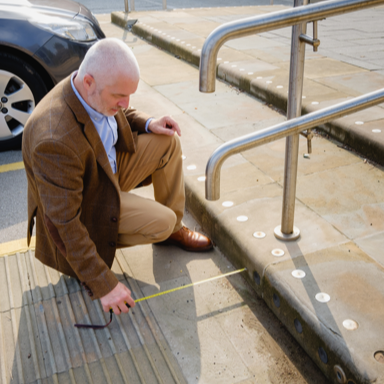 Man measuring steps